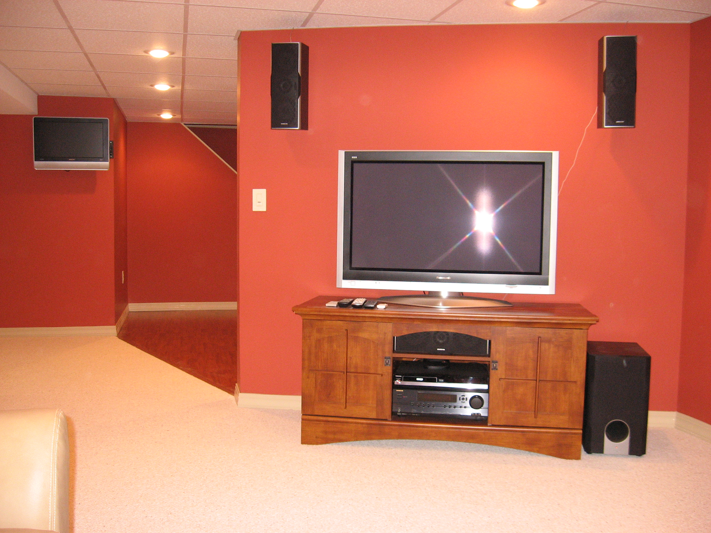 Renovated basement with new insulation, finished drywall, acoustic ceiling, laminate flooring and carpet, media components, surround sound and more