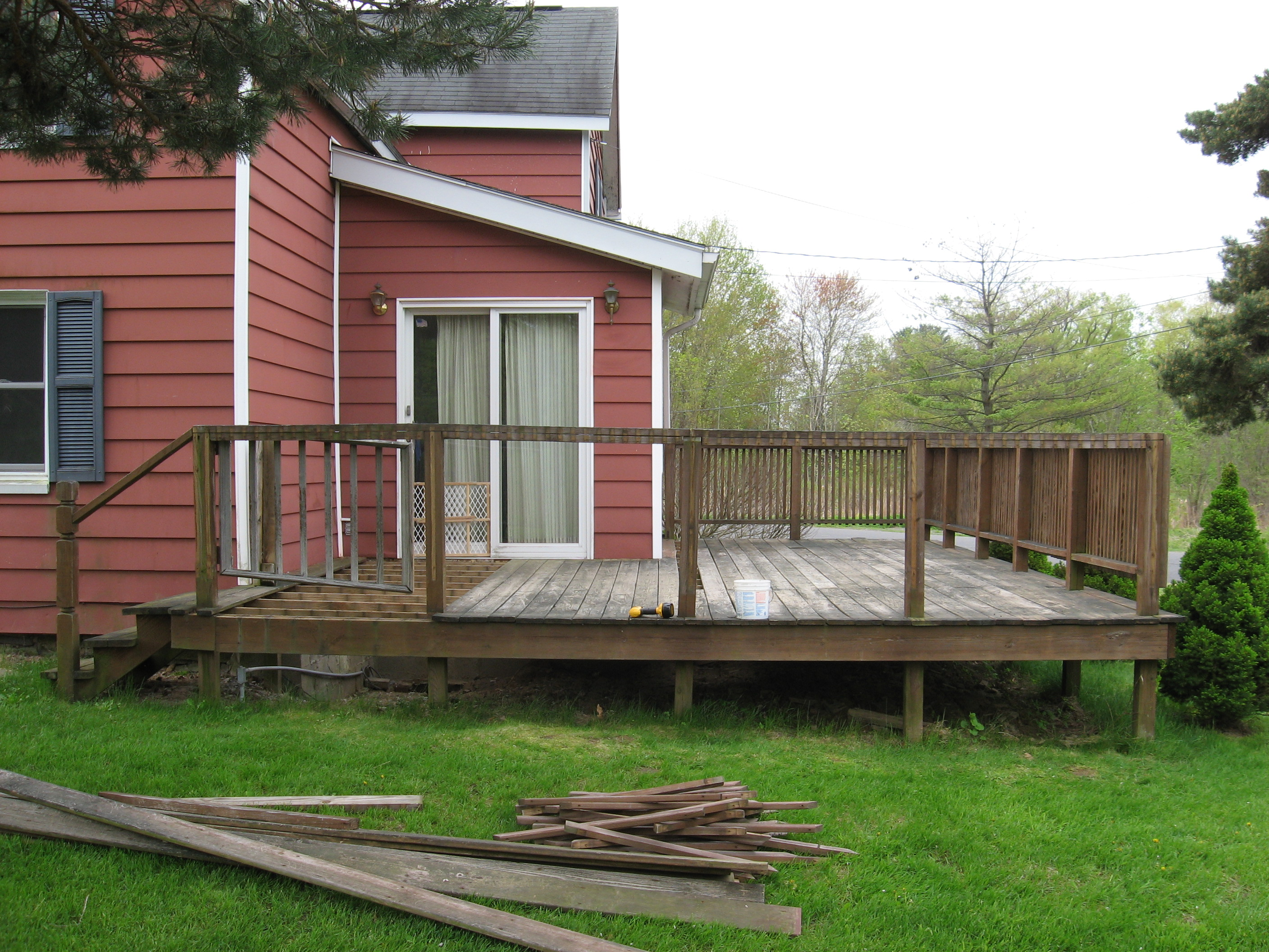 Old farmhouse with deteriorating deck