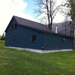 Local pine novelty siding, custom-made man doors and sliding door,