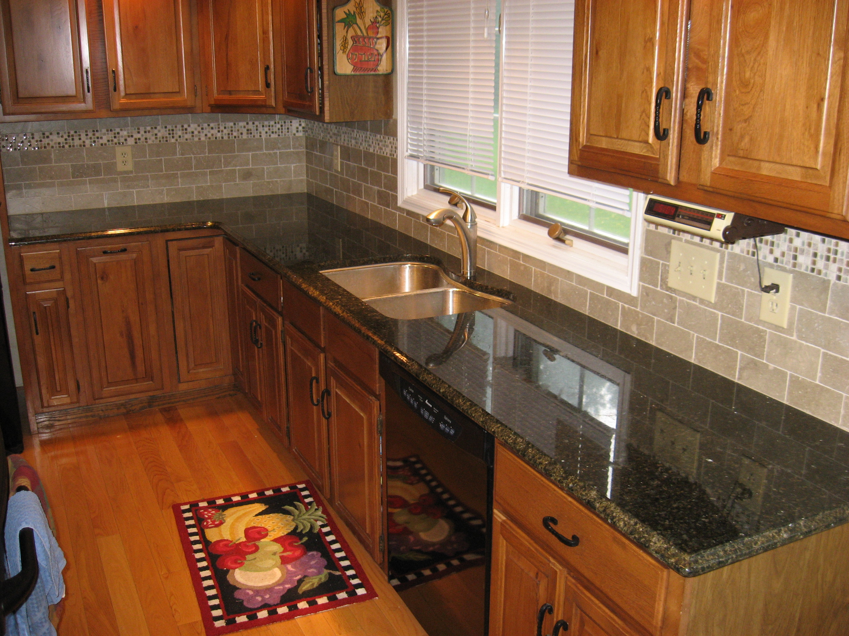 New kitchen backsplash with tumbled limestone subway tile and mixed