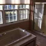 Outdated master bathroom prior to demolition