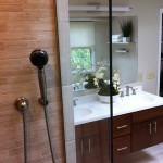 Remodeled and updated master bathroom with wall-hung vanities, Corian vanity top, and Grohe sink faucets