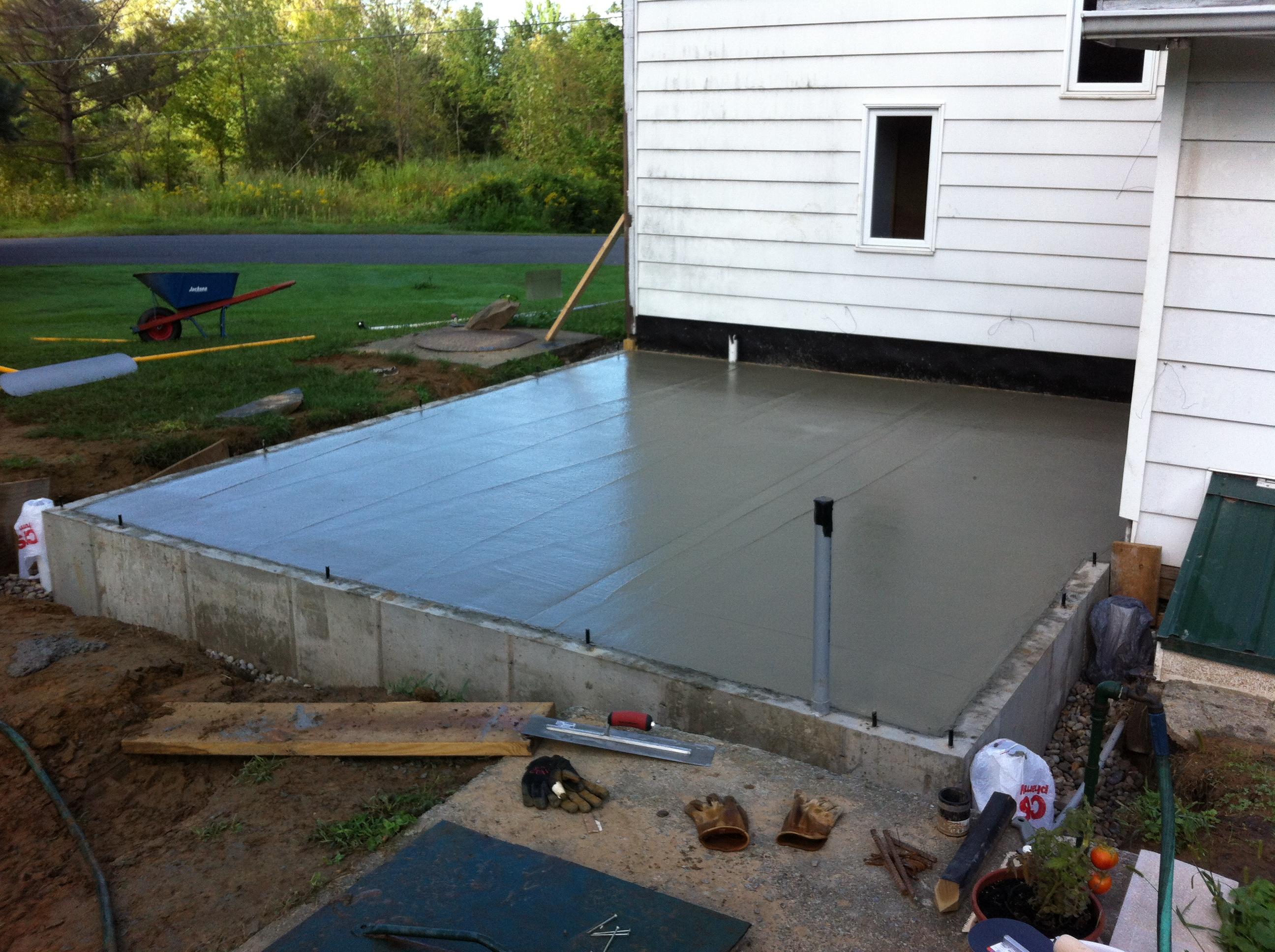 Freshly bull-floated concrete slab