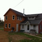 "Home addition with Pella Encompass windows, 6"" reveal pine clapboard siding, premium pine trimboards, and cedar fascia"