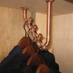 Albany Distilling Company custom sweatshirt rack using copper tubing and fittings