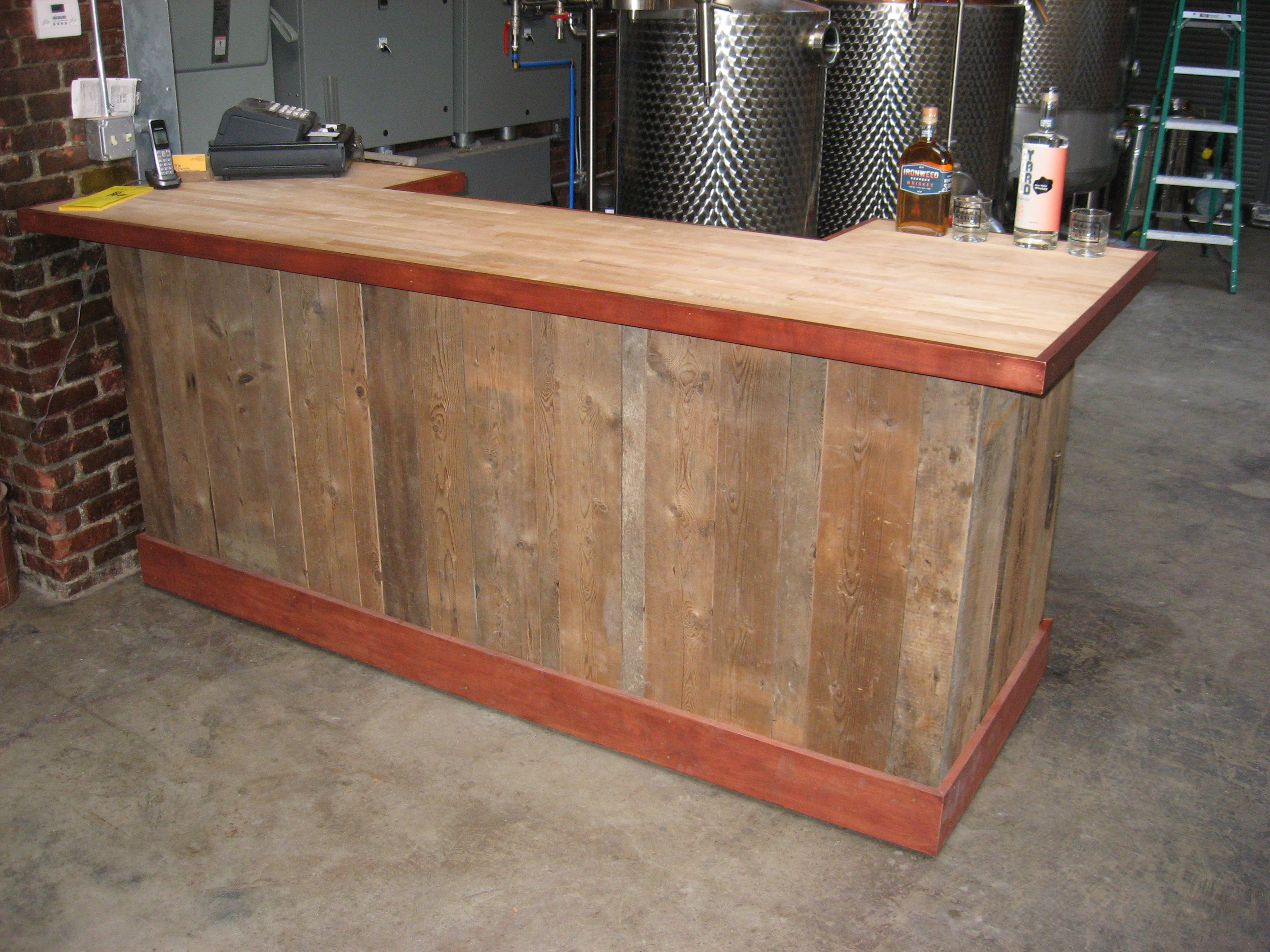 Albany Distilling Company tasting bar and sales counter constructed using maple butcher block, maple cladding, and reclaimed wood for kneewall