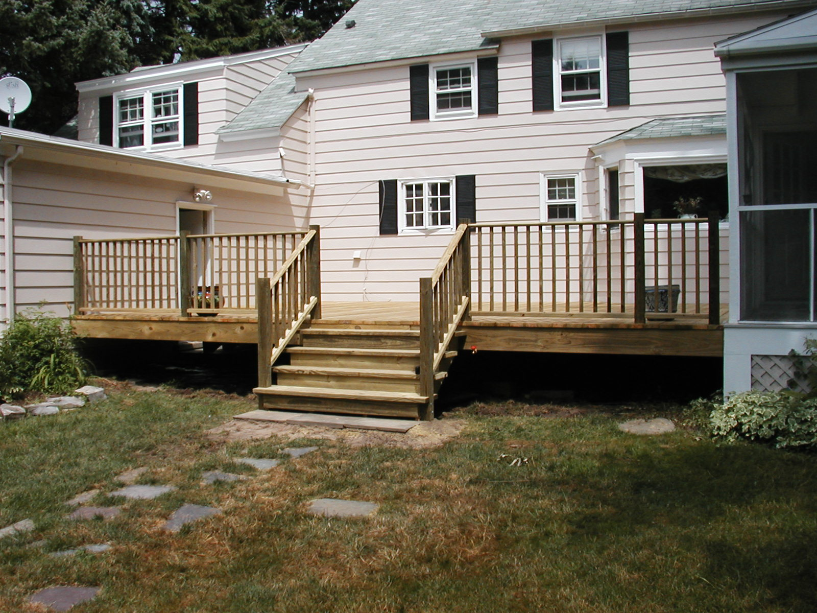 Deck with 2x6 pressure treated deckboards and railing