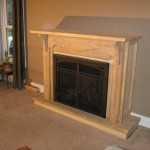 New gas fireplace with reclaimed mantel piece and reclaimed barn beam sill